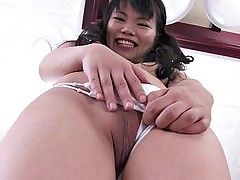 Petite shaved Asian diva spreads her pussy wide..