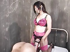 Japanese Mistress uses giant strapon on guy..